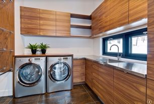 Contemporary Laundry Room with Built-in bookshelf, Stainless steel counters, Undermount sink, European Cabinets, laundry sink