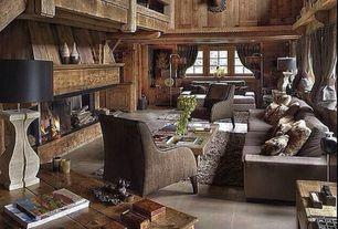 Rustic Living Room with Concrete floors, Loft, High ceiling, Built-in bookshelf, Exposed beam
