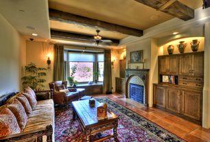 Eclectic Living Room with Wall sconce, Moorish architectural zillij tile_81, Built-in bookshelf, terracotta tile floors
