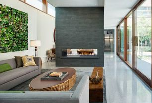 Contemporary Living Room with picture window, Paint 1, can lights, Fireplace, Polished terrazzo flooring, stone fireplace