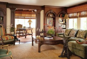 Traditional Living Room with can lights, Built-in bookshelf, Standard height, Hardwood floors, Crown molding