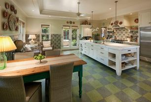 Country Kitchen with mexican tile backsplash, Custom hood, Pendant light, Ceiling fan, French doors, Flat panel cabinets