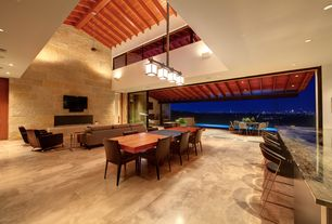 Contemporary Great Room with specialty door, sandstone tile floors, Exposed beam, stone tile floors, Fireplace, Pendant light