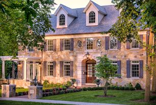 Traditional Exterior of Home with exterior tile floors, exterior brick floors, Pathway, Glass panel door, Arched window