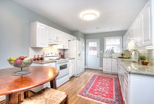 Traditional Kitchen with 24 in. 3.0 cu. ft. electric range in white, Granite countertop, U-shaped, flush light, Raised panel