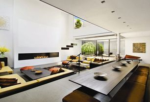 Contemporary Great Room with Double height living room, sliding glass door, High ceiling, Concrete floors, Zen viewing garden