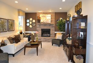 Contemporary Living Room with Carpet, Fireplace, Paint, can lights, stone fireplace, Vintage mid century coffee table