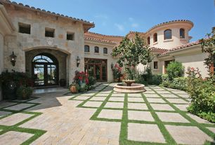 Mediterranean Landscape/Yard with Transom window, Raised beds, Bird bath, exterior brick floors, Arched window, French doors