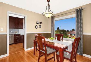 Traditional Dining Room with Pendant light, Chair rail, Hardwood floors