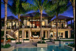 Tropical Exterior of Home with Wrap around porch, Outdoor living