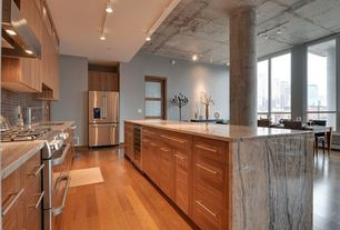 Contemporary Kitchen with Complex granite counters, Glass panel door, Kitchen island, Waterfall countertop, Cabinet, Flush