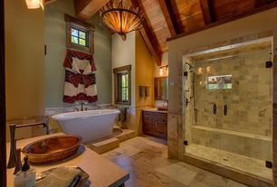 Rustic Master Bathroom with Master bathroom, Inset cabinets, flush light, Corian counters, Vessel sink, Stone Tile