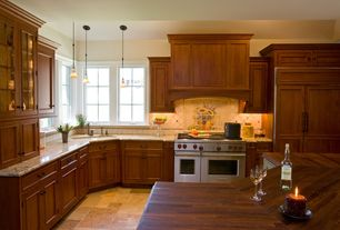 Country Kitchen with Limestone Tile, Recessed panel cabinet doors, Flat panel cabinets, Accent wall, High ceiling, L-shaped