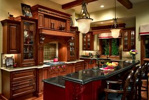 Traditional Kitchen with Soapstone counters, can lights, Standard height, Large Ceramic Tile, U-shaped, Breakfast bar