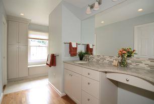 Modern Master Bathroom with wall-mounted above mirror bathroom light, three quarter bath, Hardwood floors, six panel door
