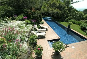 Traditional Swimming Pool with Raised beds, exterior herringbone tile floors, exterior tile floors, Lap pool