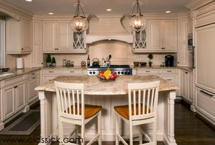 Traditional Kitchen with Stone Tile, Pier 1 Ronan Barstool, Pendant light, Limestone Tile, Custom hood, Crown molding