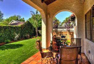 Mediterranean Porch with Fence, Screened porch, exterior terracotta tile floors, Casement, exterior tile floors