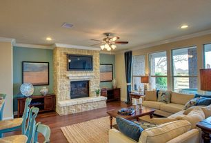 Traditional Living Room with can lights, Ceiling fan, Standard height, stone fireplace, Crown molding, Hardwood floors