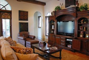 Traditional Living Room with Arched window, High ceiling, French doors, Exposed beam, terracotta tile floors