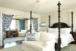 Traditional Master Bedroom with Laminate floors, Crown molding, Chandelier, Built-in bookshelf