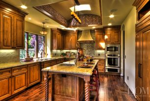 Mediterranean Kitchen with Built In Panel Ready Refrigerator, can lights, electric cooktop, U-shaped, Undermount sink