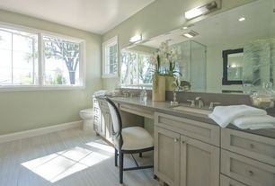 Traditional Master Bathroom with Flat panel cabinets, can lights, frameless showerdoor, Standard height, Limestone, Casement