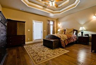 Traditional Master Bedroom with Hardwood floors, Ceiling fan, Wall sconce, French doors