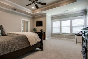 Traditional Master Bedroom with Standard height, Crown molding, Ceiling fan, Carpet, can lights, double-hung window