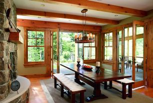Rustic Dining Room with Chandelier, Exposed beam, French doors, can lights, double-hung window, Standard height