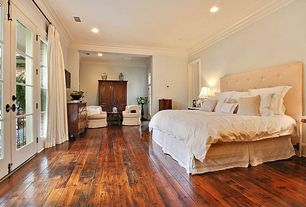 Traditional Master Bedroom with Standard height, Hardwood floors, French doors, Crown molding, can lights