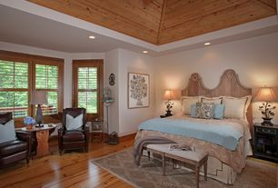 Traditional Master Bedroom with can lights, Hardwood floors, High ceiling, specialty window