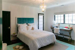 Contemporary Guest Bedroom with French doors, Standard height, Crown molding, Casement, Art desk, Hardwood floors, Chandelier