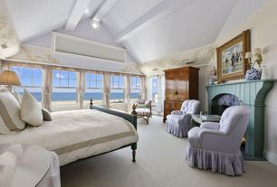 Cottage Master Bedroom with Crown molding, Exposed beam, French doors, Carpet, stone fireplace, Wall sconce