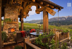 Country Deck with outdoor pizza oven, Fence, Eldorado Stone Shadow Rock, Mountain view, Outdoor fireplace, Covered deck