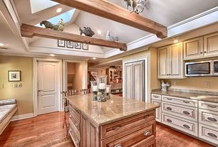 Country Kitchen with Crown molding, Standard height, Built In Panel Ready Refrigerator, Simple Granite, can lights, Skylight