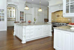Kitchen with Raised panel, full backsplash, Simple granite counters, can lights, Custom hood, Stone Tile, Limestone Tile