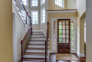 Traditional Entryway with Hardwood floors, Casement, French doors, Cathedral ceiling, Built-in bookshelf