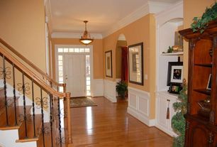 Traditional Entryway with Crown molding, flat door, Transom window, Wainscotting, Hardwood floors, Standard height