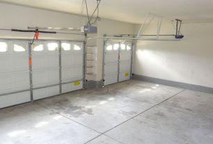 Traditional Garage with specialty door, Concrete tile , Standard height