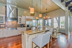 Cottage Kitchen with Breakfast bar, Flat panel cabinets, electric cooktop, Inset cabinets, One-wall, French doors, can lights