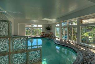 Tropical Swimming Pool with Transom window, exterior tile floors, Indoor pool
