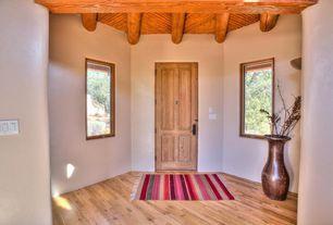 Eclectic Entryway with Exposed beam, specialty door, Hardwood floors