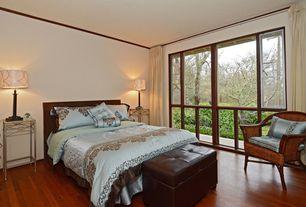 Art Deco Master Bedroom with Hardwood floors, Crown molding