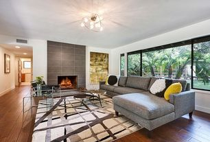 Modern Living Room with Hardwood floors, Marcel breuer wassily chair, Standard height, Area rug, Paint, picture window