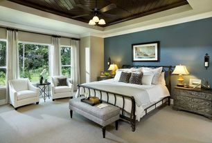 Traditional Master Bedroom with Crown molding, Candle sconce, Sleigh wrought iron bed, West Elm Sweep Leather Armchair, Bench