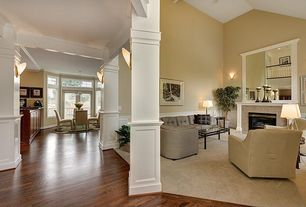 Traditional Living Room with Columns, Fireplace, stone fireplace, can lights, Wainscotting, Carpet, Wall sconce