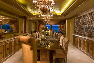 Mediterranean Dining Room with picture window, Chandelier, Crown molding, sandstone tile floors, Columns, can lights