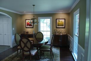 Traditional Dining Room with Iron and crystal parisian small chandelier, Chandelier, Wainscotting, Crown molding
