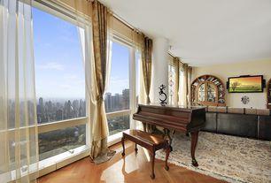 Traditional Living Room with Columns, picture window, Built-in bookshelf, Standard height, Hardwood floors